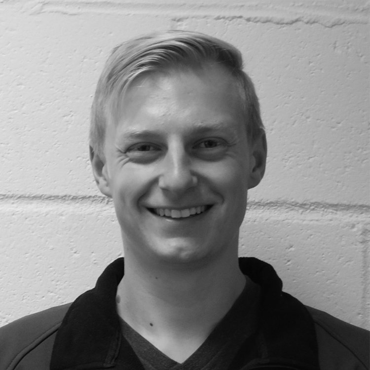 black and white head shot of a millennial man