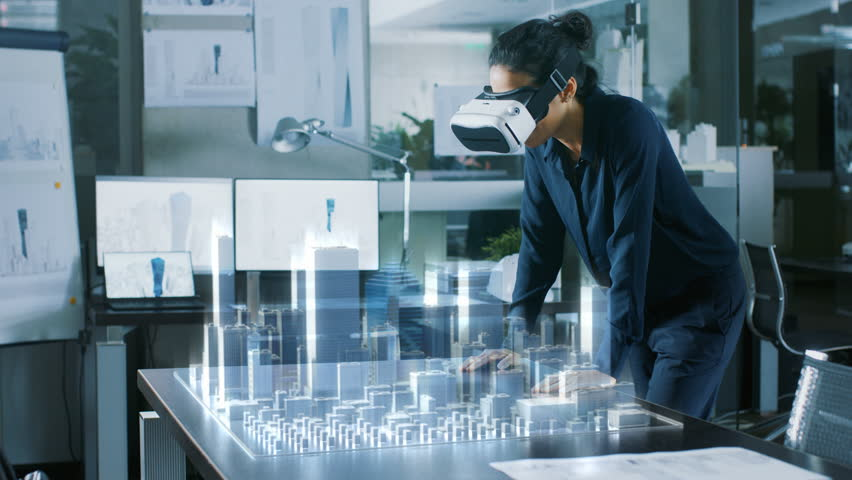 Dark Haired Woman Using Augmented Reality Headset in a lab