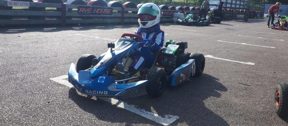 Boy in race car on a race track