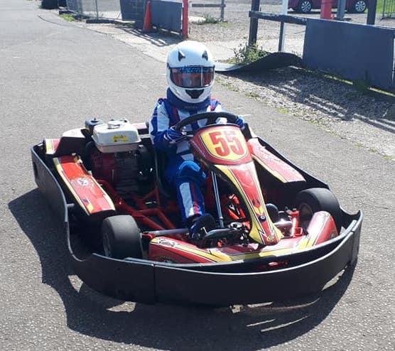Boy in a race car on a race track