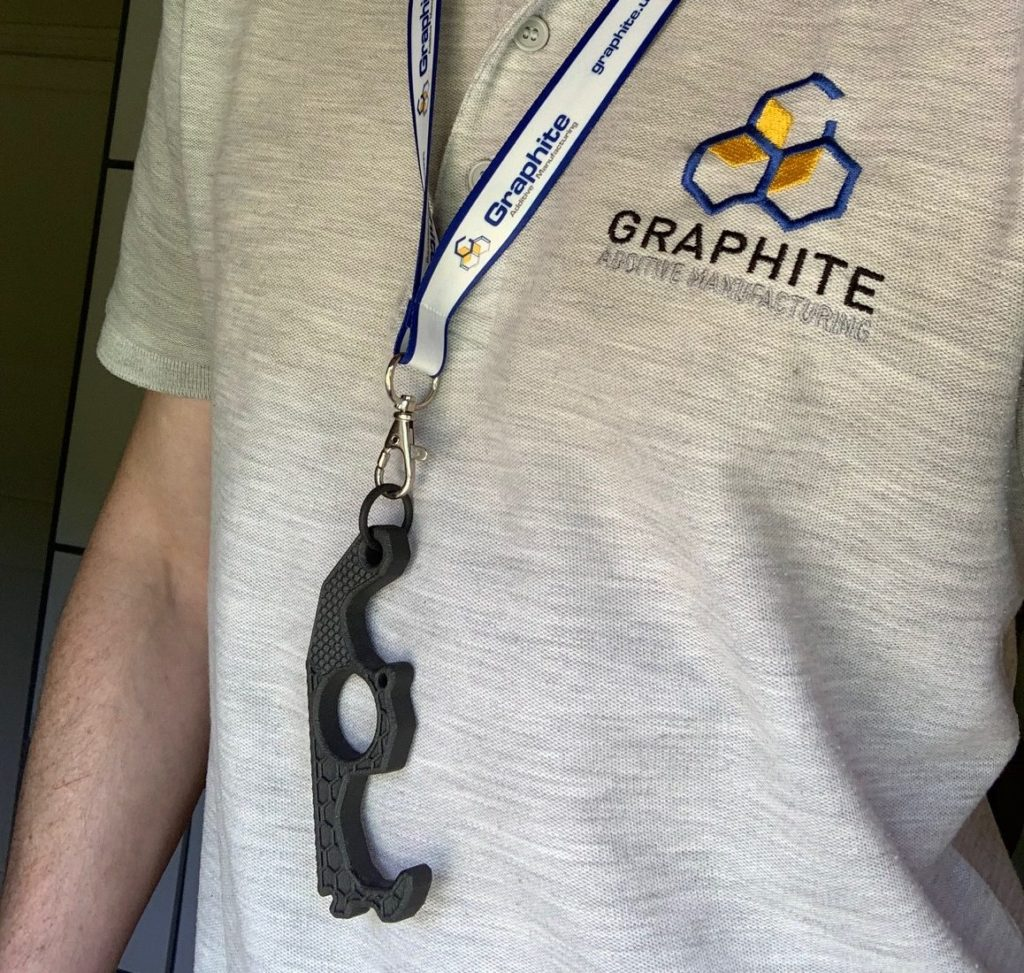 The COVID tool on a lanyard